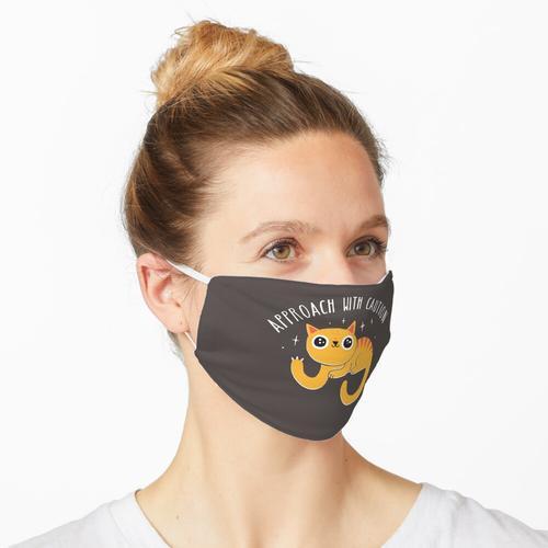 Ansatz mit Vorsicht Maske