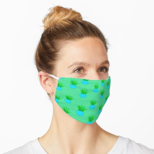 Blattpflanze im Topf Maske