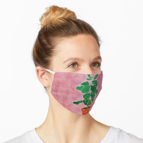 Eine Zimmerpflanze Maske